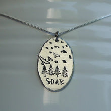 Load image into Gallery viewer, Silver pendant with birds soaring over a forest