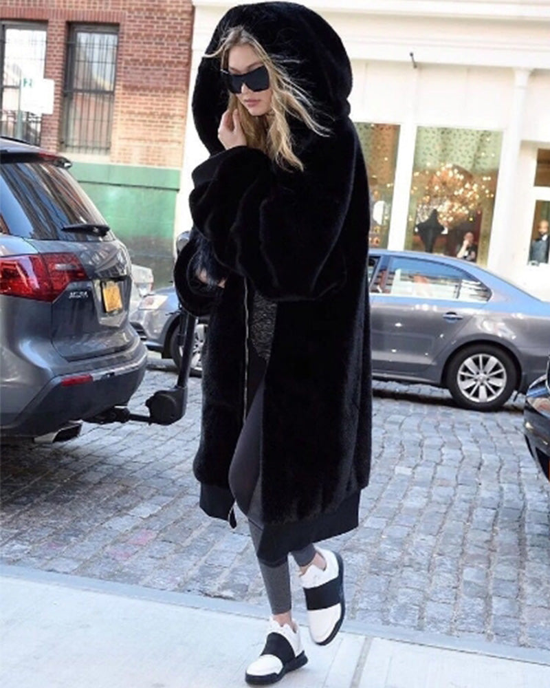 stunning gigi hadid walking outside wearing her oslo black oversized faux fur coat