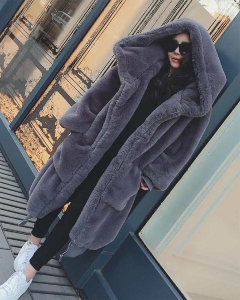 fashion model standing outside wearing her oslo grey oversized faux fur coat