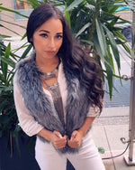 stylish young lady with black hair wearing a new york grey faux fur vest | furever faux fur