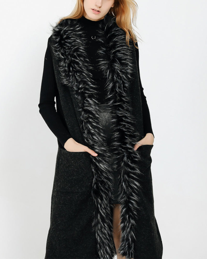 fashion model standing and wearing a stockholm black faux fur vest