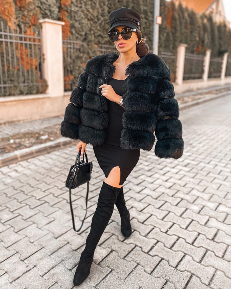 elegant woman wearing all black in a chicago black faux fur coat