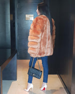 beautiful lady standing in hallway wearing the moscow brown faux fur coat