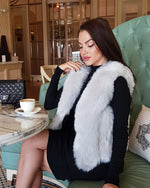 young lady sitting on couch wearing a paris white grey faux fur vest | furever faux fur