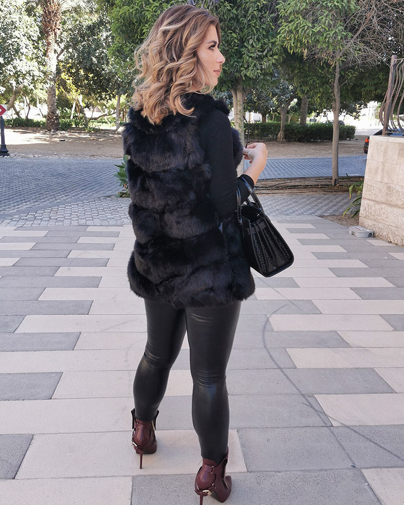 classy lady standing on the street and wearing a vienna black faux fur vest