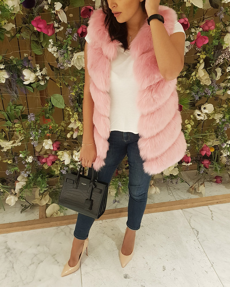 stylish ladies outfit wearing jeans and a vienna pink faux fur vest