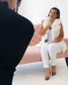 famous make up artist Angelique Turner wearing a vienna white faux fur vest