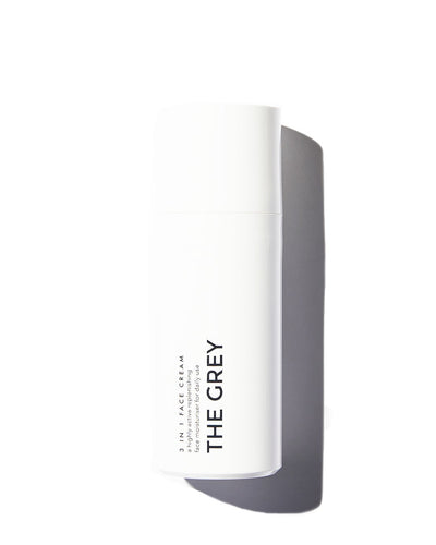 The Grey Face Cream in white cylindrical container with black text on white background