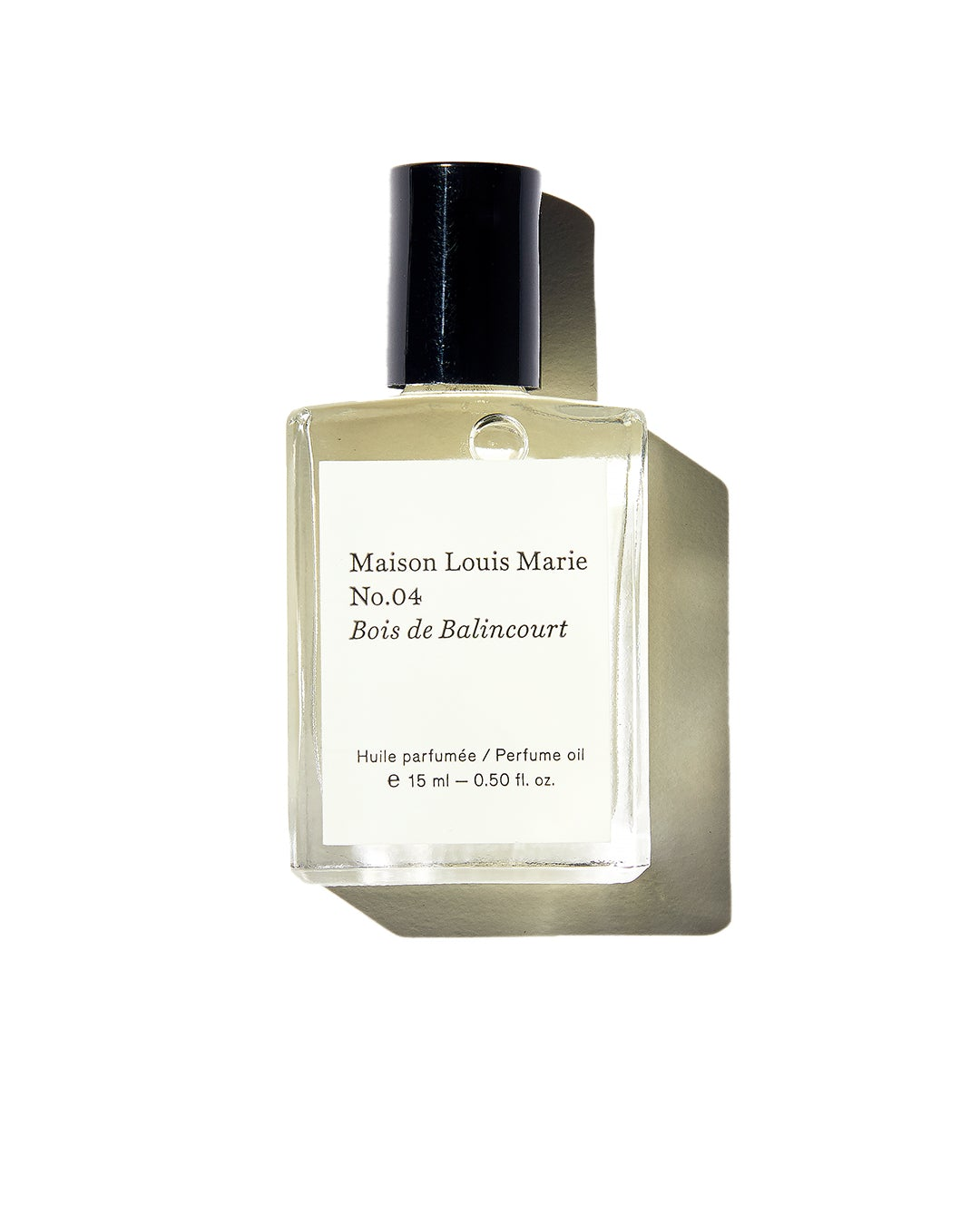 Glass Maison Louis Marie perfume bottle with white label and black lid on white background