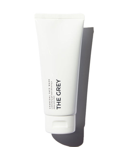 The Grey Charcoal Face Wash in white tube on white background