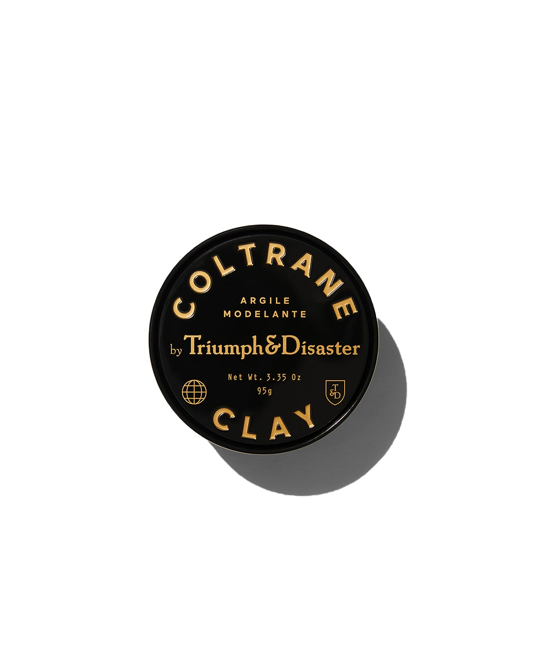 Triumph & Disaster Coltrane Clay hair product in black jar with gold text on white background