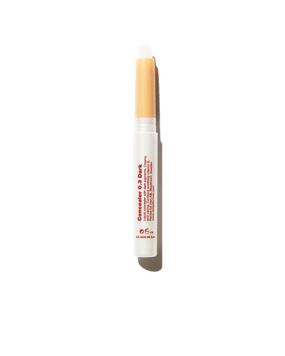 Recipe for Men white concealer stick in dark shade on white background