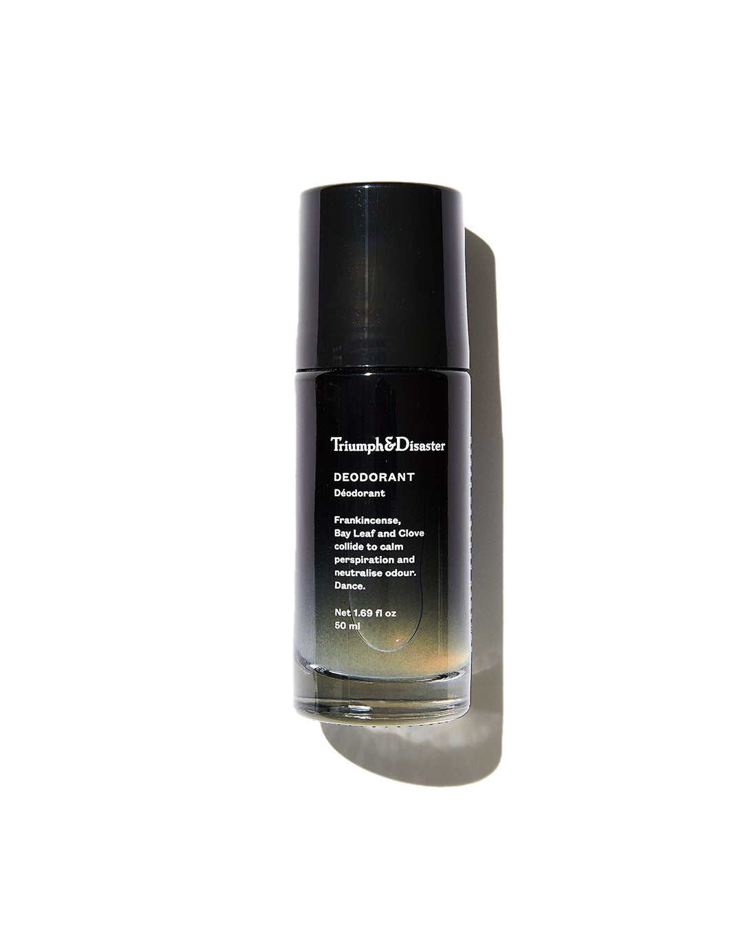 Triumph & Disaster Deodorant in black glass bottle on white background