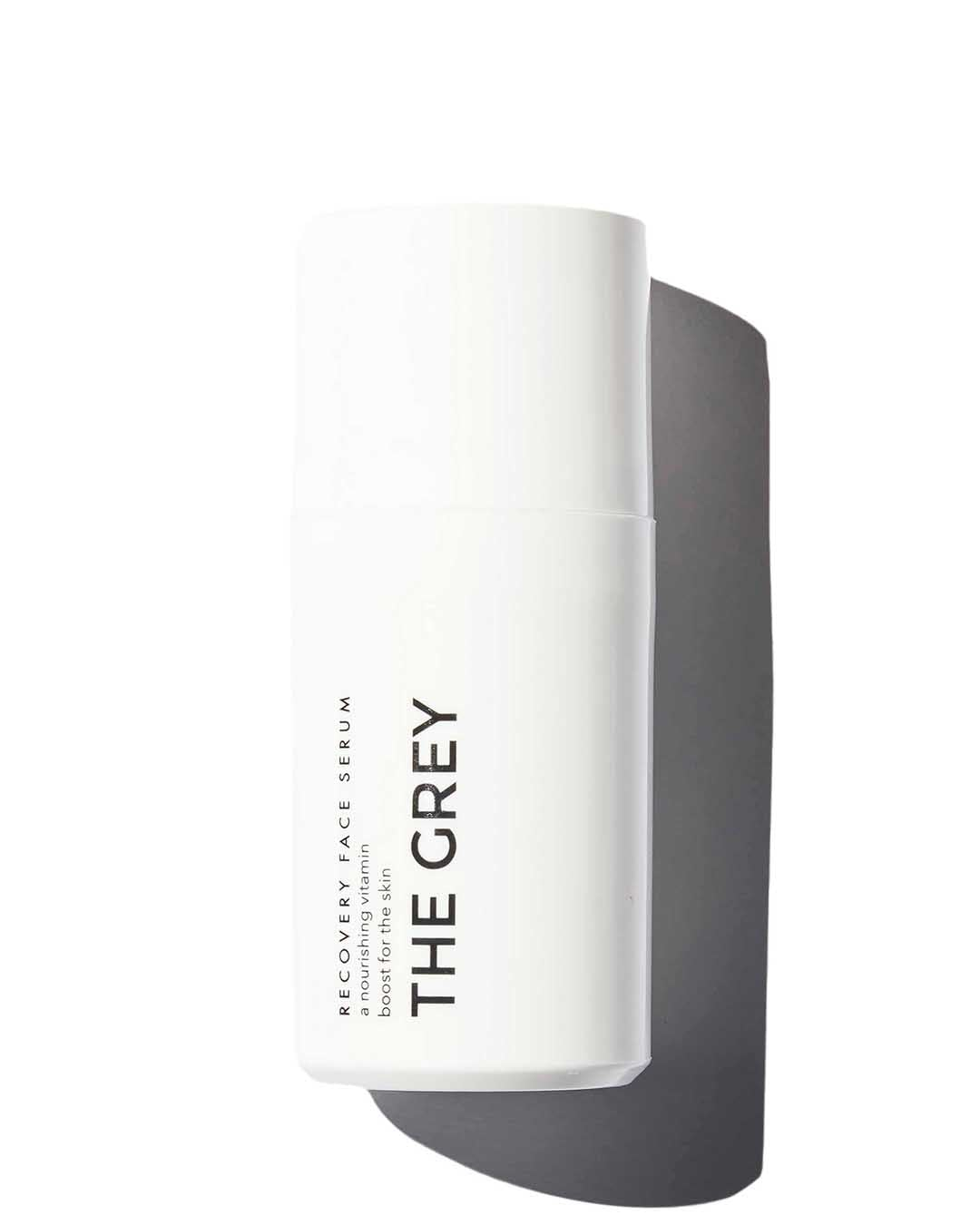 The Grey Recovery Face Serum in round white container on white background