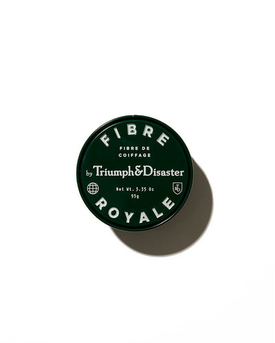 Triumph & Disaster Fibre Royale hair product in black jar on white background
