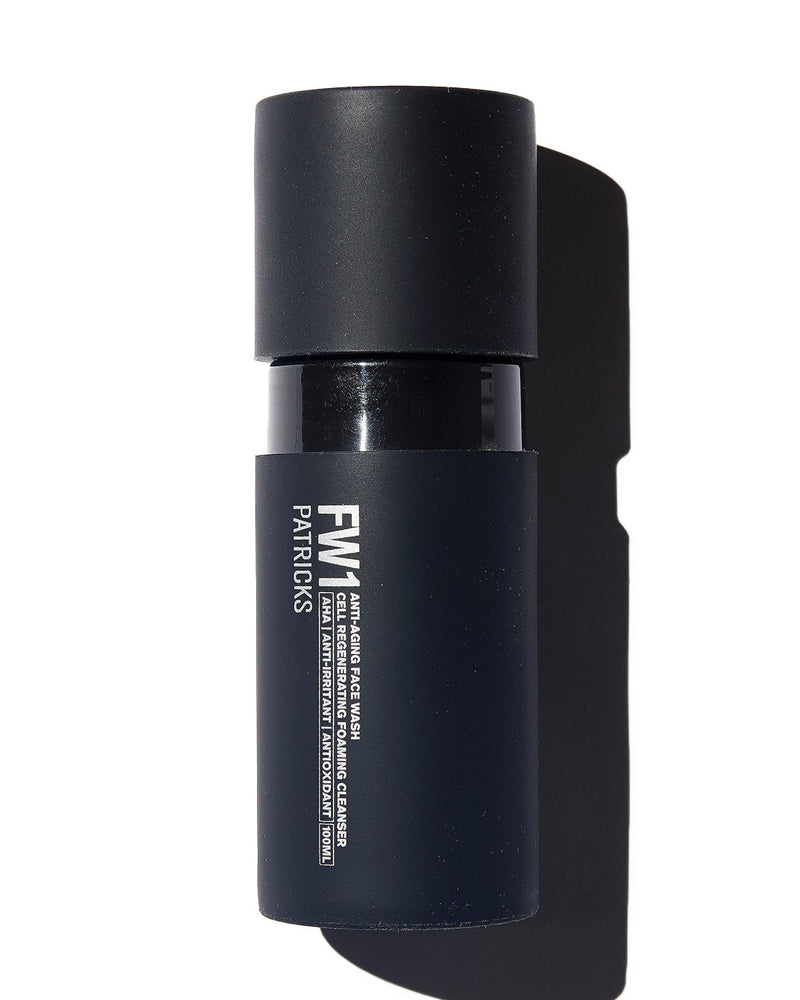 Patricks black cylindrical Face Wash bottle on white background