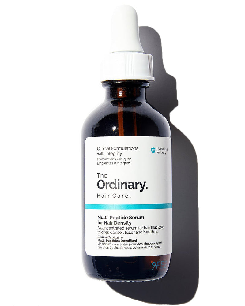 The Ordinary Multi-Peptide Serum for Hair Density in brown glass dropper bottle with white lid on white background