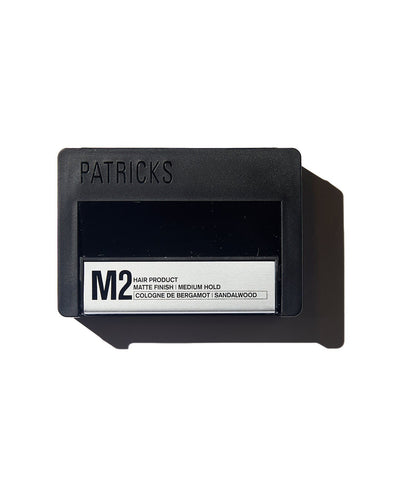 Patricks Medium Hold hair product in black rectangular container with silver label on white background