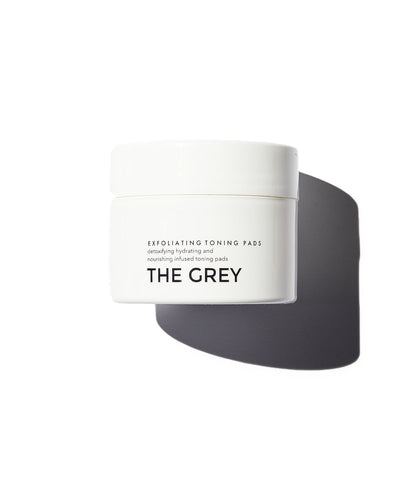 The Grey Exfoliating Toning Pads in white jar on white background
