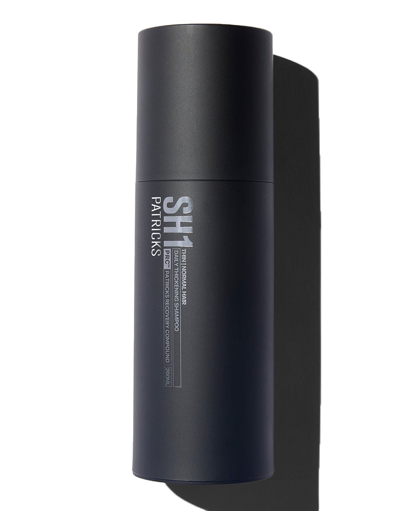 Patricks Thinning and Normal hair shampoo in black cylindrical bottle on white background