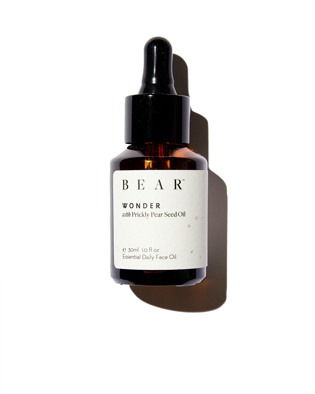Bear face oil dropper bottle on white background
