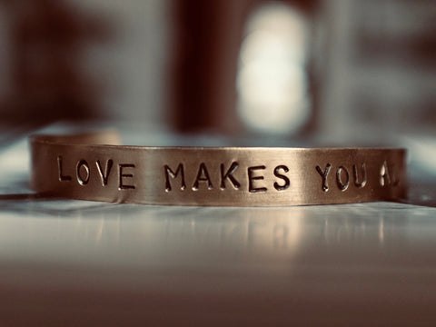Hand Stamped LOVE MAKES YOU ALIVE cuff
