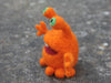 """Orange Monster"" needle felted friend"