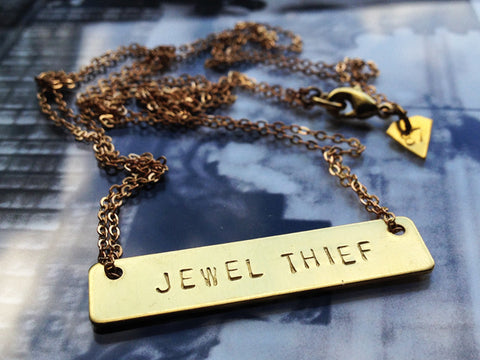 "Raw brass ""JEWEL THIEF"" necklace"