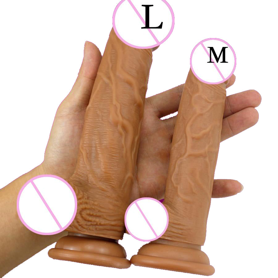 Realistic Skin Texture Dildo size comparison of large and medium with hand