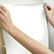 Dry Erase Peel and Stick Wallpaper hang