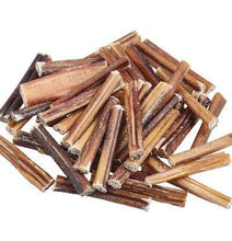 Load image into Gallery viewer, Dog chews. Bully sticks. Close up of a bunch of bully sticks..