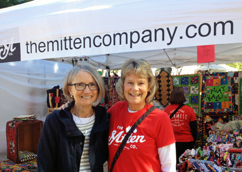 Deb meets one of our customers of The Mitten Company at a craft show in the Wisconsin Dells