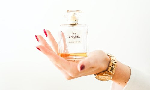 Holding a perfume bottle