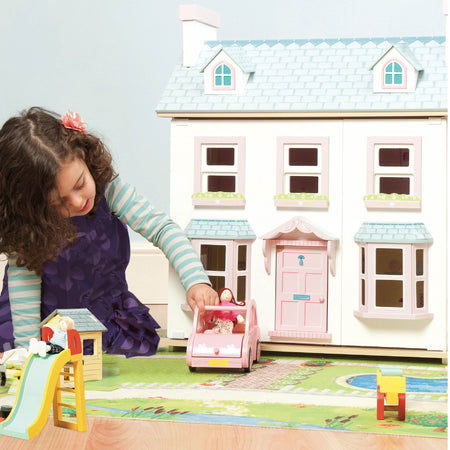 Wooden doll house & wooden doll house accessories including wooden dolls, cars, furniture & wooden people. This Le Toy Van doll house comes complete with doll house furniture.