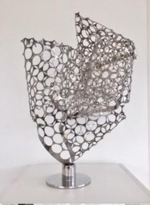"""The sculpture is intended as a futuristic symbol of a map, developed  from a 3-D  visualization of object in their space. Perforated stainless steel mesh, randomly kneaded manually, I've welded it to a solid steel base.""  Artist: Luiz Campoy  Medium: Stainless steel  Dimensions: 30 x 40 x 50cm  Genre: Sculpture  Year: 2019"