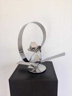 His ingenious conceptual art creations are contemporary forms that are aesthetically pleasing to the viewer, left for interpretation.  These stainless steel plate tapes are guillotine cut, twisted and welded to create movement, an action and reaction.  Artist: Luiz Campoy  Material: Stainless steel  Dimensions: 40 x 20 x 36cm  Genre: Sculpture  Shipping worldwide