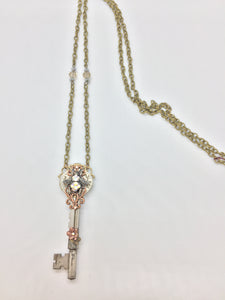 2 vintage keys create this unique necklace; copper filligree & brass connectors; accented with Aurora Borealis, Swarovski crystals