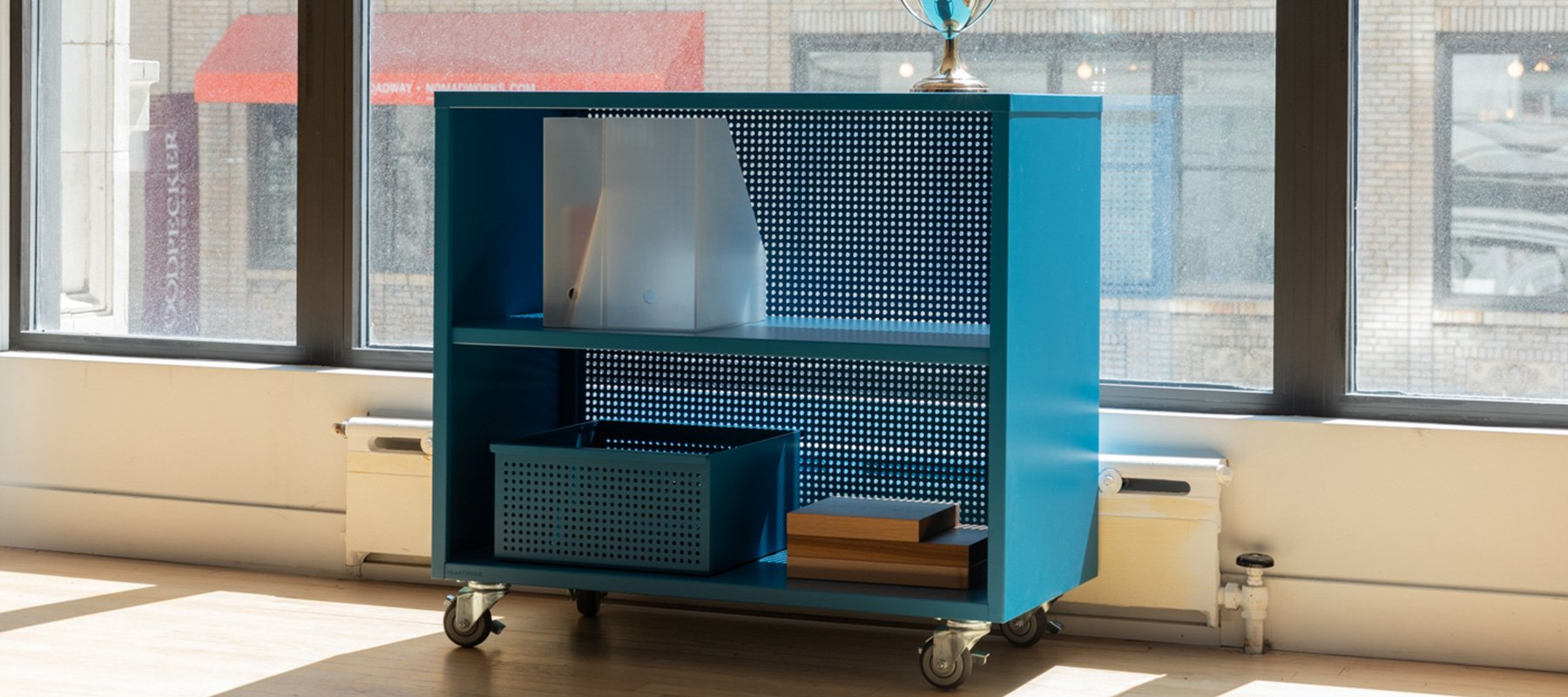 Heartwork Active Duty bookcase in true blue in office setting
