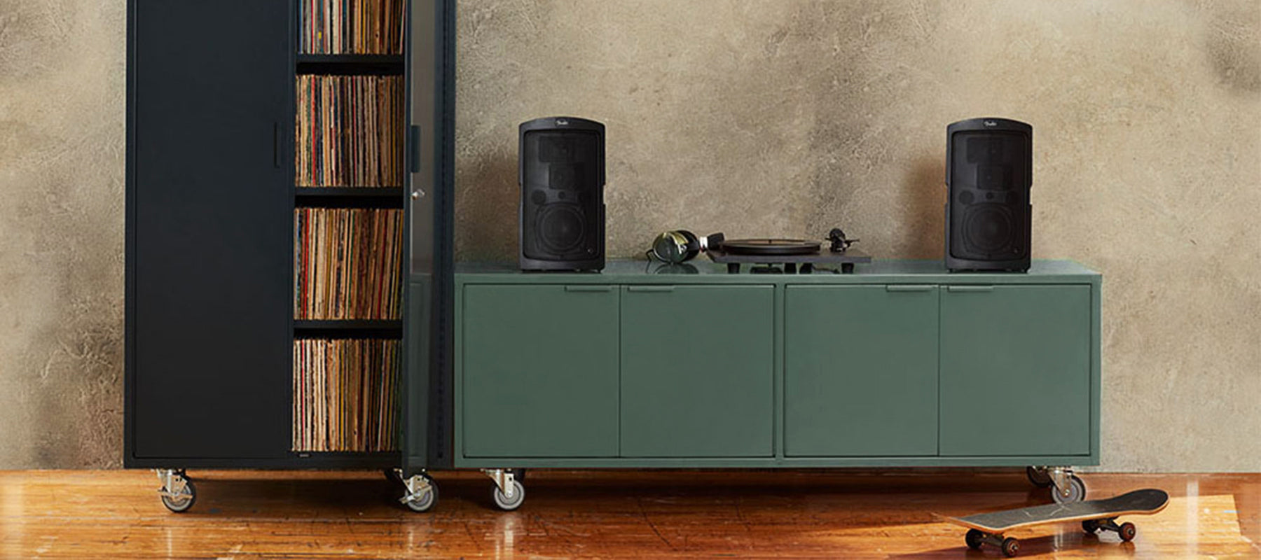 Heartwork Active Duty A/V Crdenza in deep green with speakers and record player in home setting