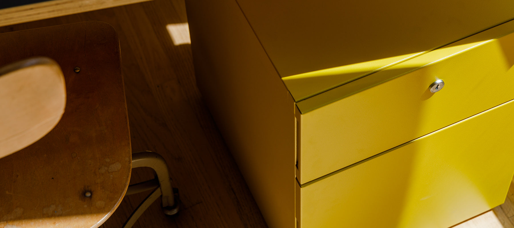 Heartwork Building Block Pedestal in warm yellow under a desk
