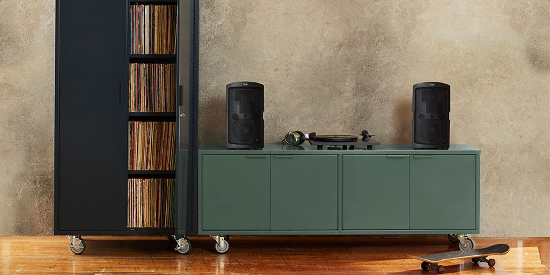 Heartwork Active Duty A/V credenza in deep green with record player and speakers in home setting