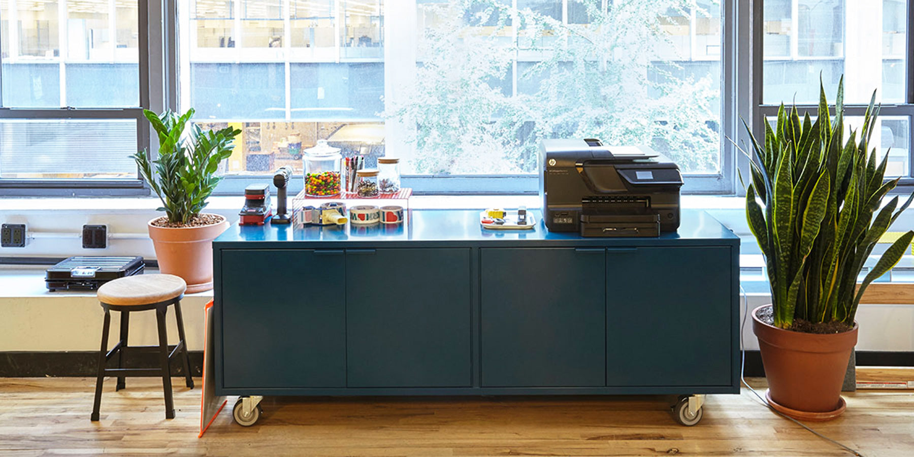 Heartwork Active Duty storage credenza in blue in a home setting with printer and objects on top