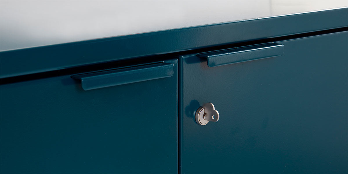 Detail of Heartwork Active Duty storage credenza showing handle and heart-shaped key