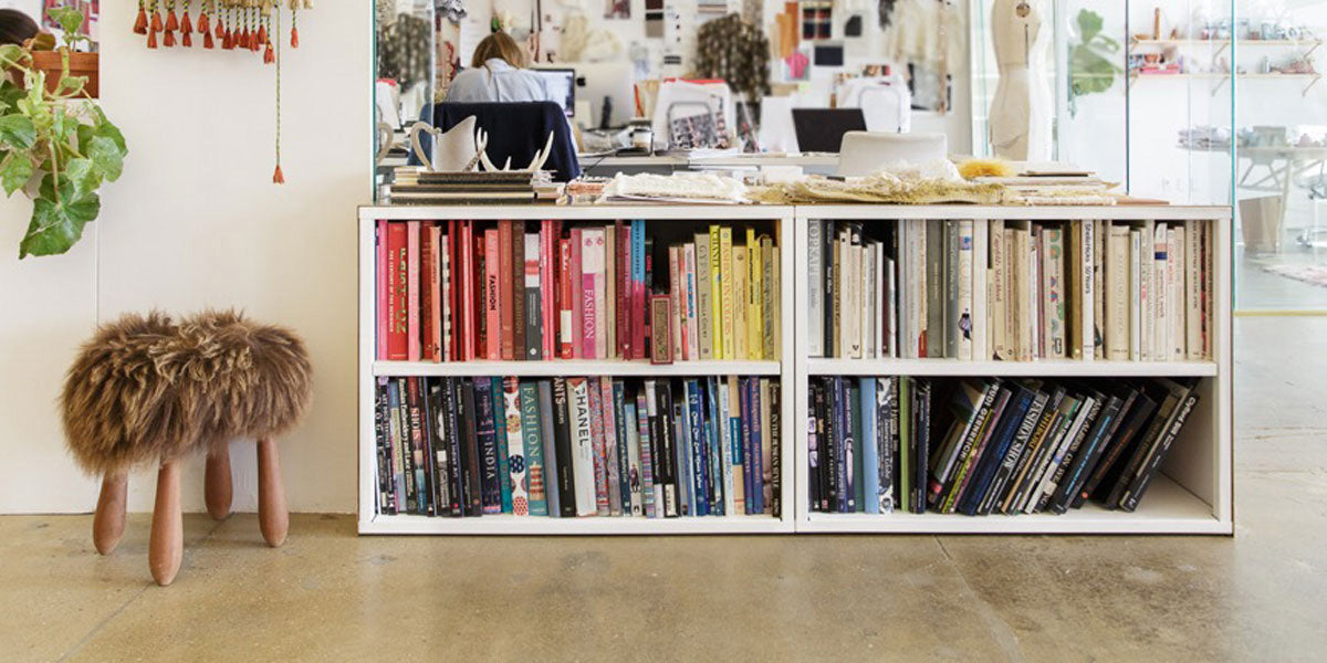 Heartwork Building Block bookcases loaded with colourful books in office setting