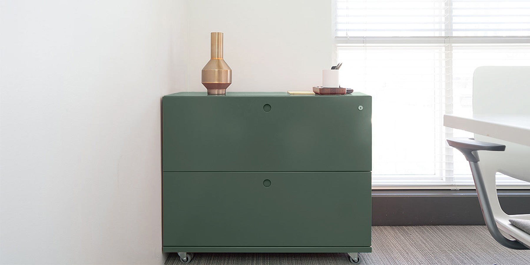 Heartwork Building Block lateral file with two drawers in green in office setting