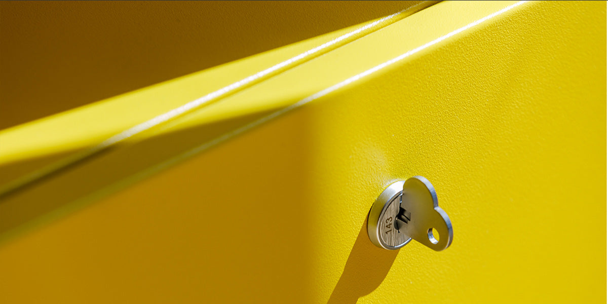 Detail of Pedestal in yellow showing a heart shaped key