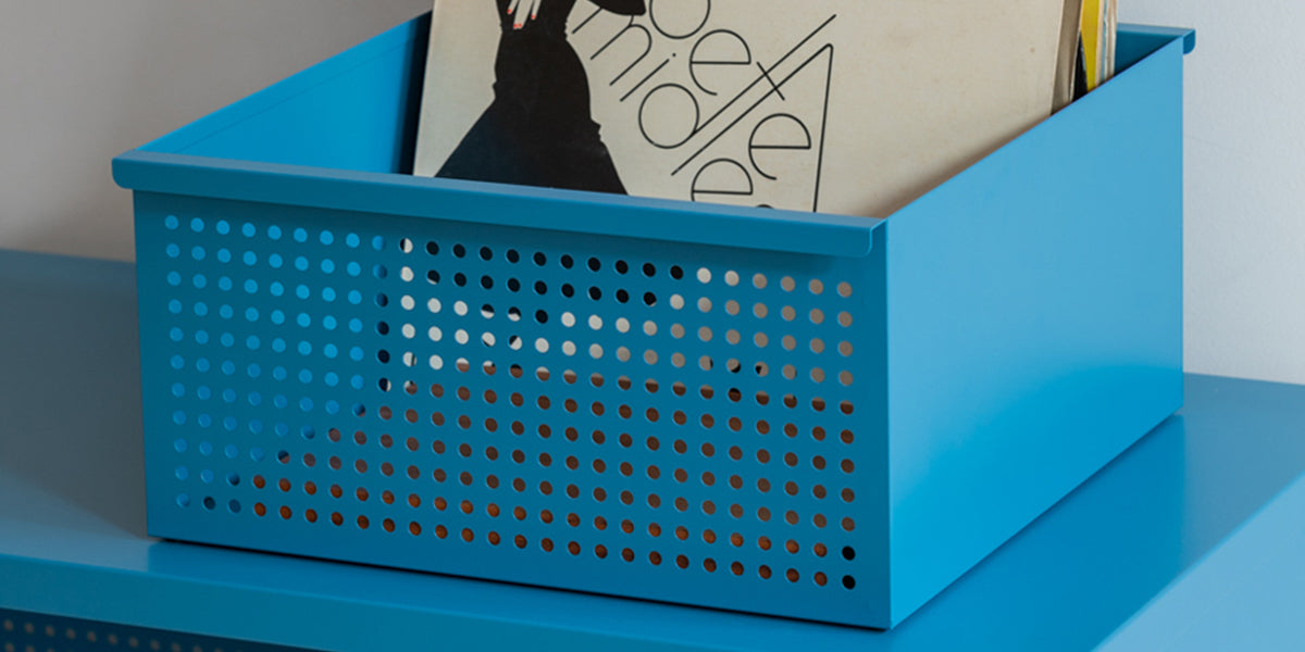 Heartwork Perforated Basket in blue with records inside