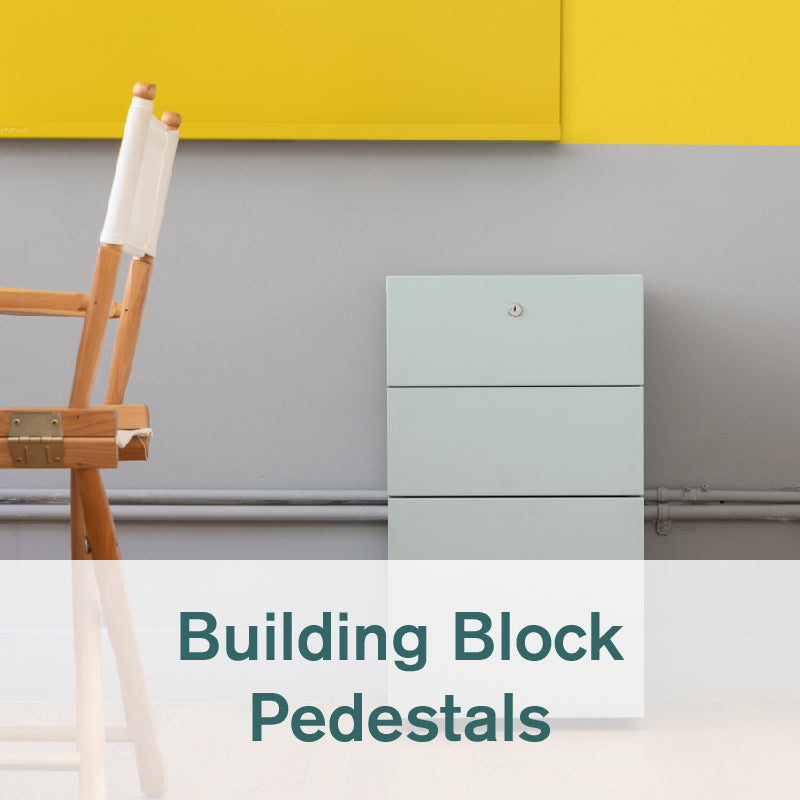 Heartwork Building Block pedestal in fresh mint next to a chair in office setting