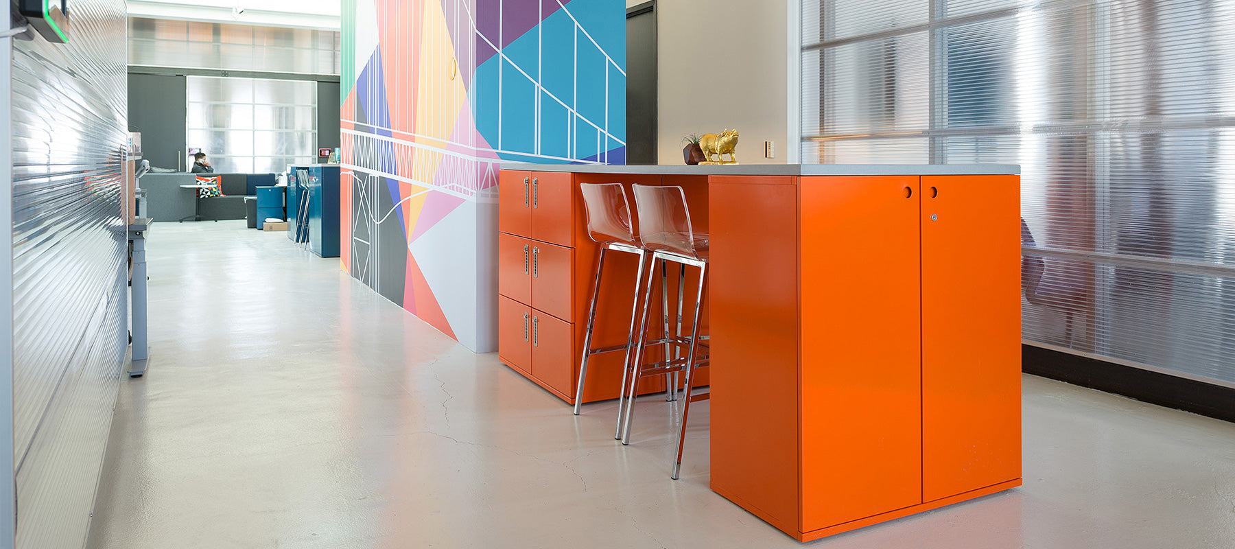 Heartwork Building Block endcaps and lockers in warm orange arranged as workbar in office setting
