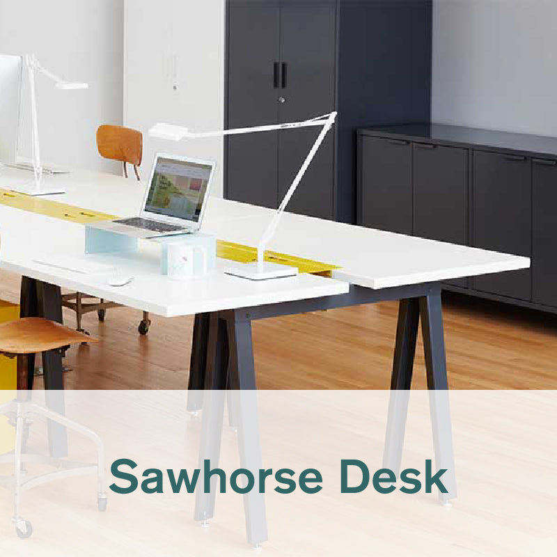 Heartwork Sawhorse desk with white top and black frame in office setting